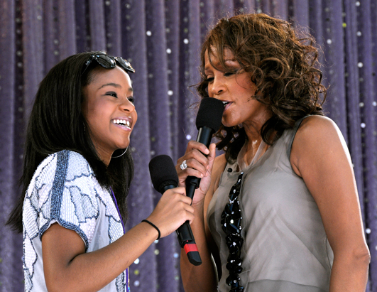 photo from ABC News. Whitney onstage with daughter Bobbi Christina.