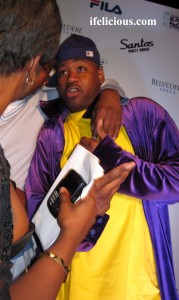 Psycho PR chick is cock blockin my shot of Ghostface Killah and whoever he's posing with.  Photo by:  Ife Blount
