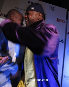 Ghostface Killah hugs (unknown).  Still trying to get that money shot! LOL.  Photo by:  Ife Blount